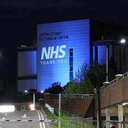 Milner Institute illuminated blue for the NHS